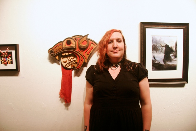 "Josie Doggett and her piece titled ""of the Valley of the Headless Man"". What was amazing about her piece is that it isn't one piece, but several different layers of wood stained, painted and sandwiched together to create this Native American art inspired sculpture."