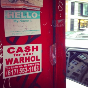 On a busted phone booth in Chinatown